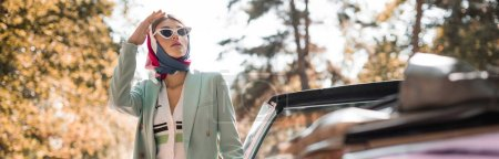 Photo for Stylish woman looking away near cabriolet car outdoors, banner - Royalty Free Image