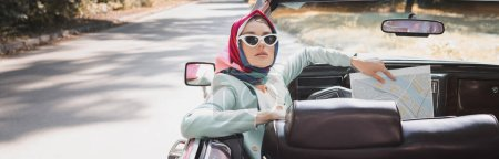 Photo for Elegant woman holding map on driver seat of vintage auto, banner - Royalty Free Image