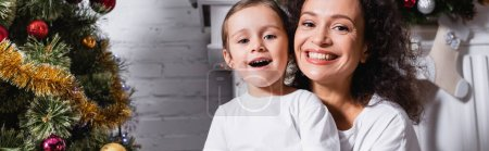 Photo for Panoramic shot of mother and daughter with open mouth looking at camera - Royalty Free Image