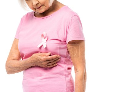 Photo for Cropped view of elderly woman in pink t-shirt with ribbon of breast cancer awareness isolated on white - Royalty Free Image
