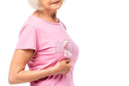 Cropped view of elderly woman with pink ribbon on t-shirt isolated on white