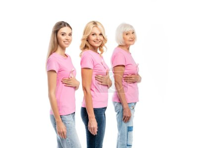 Photo for Women with pink ribbons on t-shirts looking at camera isolated on white - Royalty Free Image