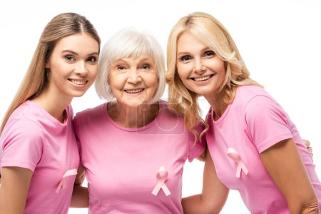 Women with pink ribbons on t-shirts hugging isolated on white