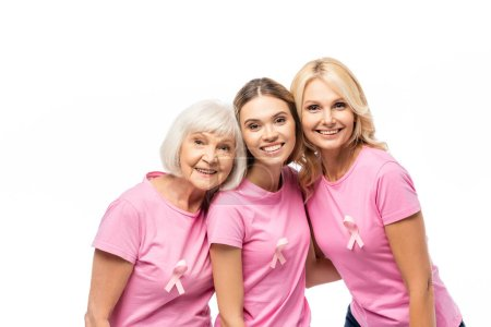 Women with pink ribbons on t-shirts looking at camera isolated on white