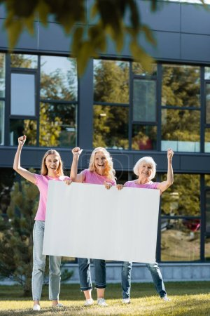 Photo for Three women with yes gestures holding empty board, concept of breast cancer - Royalty Free Image