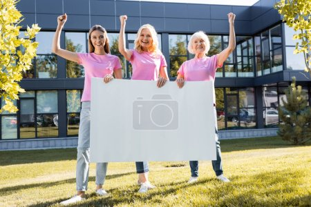 Photo for Three women with yeah gestures holding empty board, concept of breast cancer - Royalty Free Image