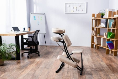 Photo for Interior of spacious office with modern design and massage chair - Royalty Free Image