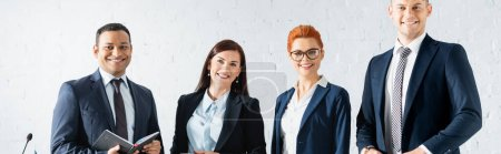Photo for Happy multicultural politicians looking at camera in boardroom, banner - Royalty Free Image