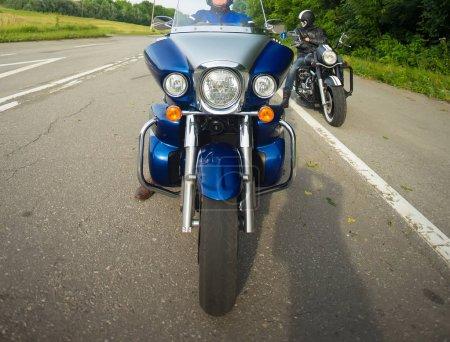 bikers sitting on their bikes, big chopper bike, sport bike on road