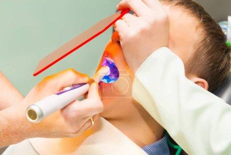 young man visiting the dentist, closeup