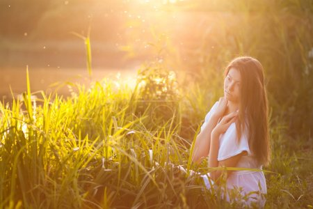 beautiful young woman relaxing outdoor standing in river