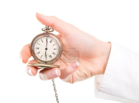 Photo pour Femme main tenant la montre de poche isolée sur fond blanc - image libre de droit