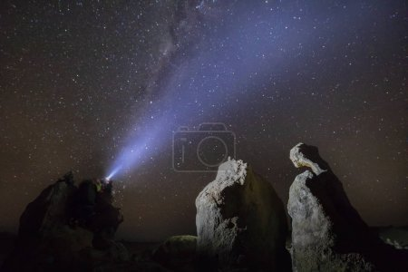 Photo for Astronomer man looking night sky through amateur telescope - Royalty Free Image