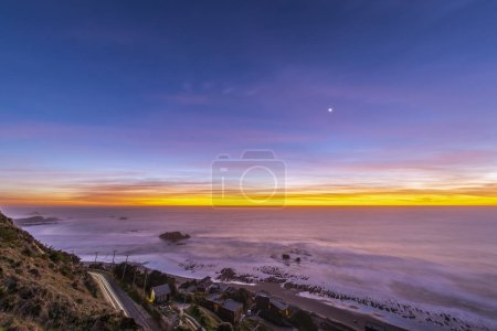 """Photo for Amazing sunset over the Pacific Ocean at """"Puertecillo"""" beach, Santiago de Chile - Royalty Free Image"""