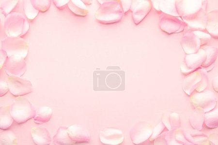 Photo for Rose flower petals on a pink, pastel background - Royalty Free Image