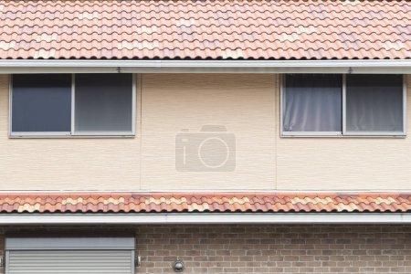 Metal windows on second floor of house