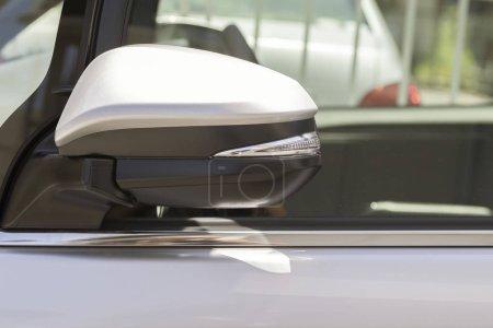 Closeup of car rear view mirror at daytime