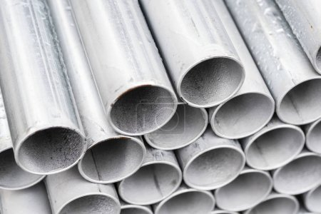Close-up stack of metal pipe