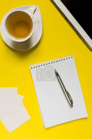 Photo for Styled  photography yellow office desk table with blank notebook, computer, supplies and tee cup. - Royalty Free Image