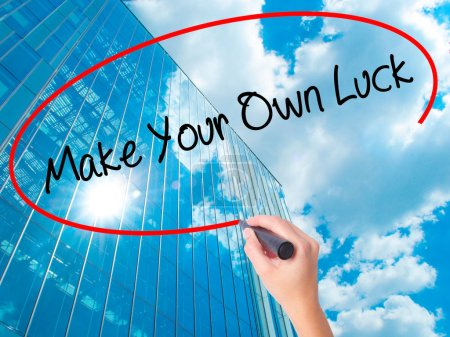 Photo for Women Hand writing Make Your Own Luck with black marker on visual screen. Isolated on skyscraper. Business, technology, internet concept. Stock Photo - Royalty Free Image