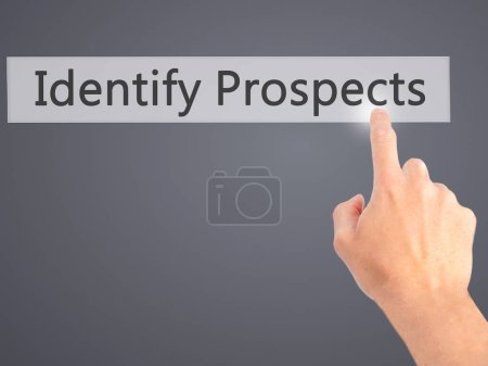 Photo for Identify Prospects  - Hand pressing a button on blurred background concept . Business, technology, internet concept. Stock Photo - Royalty Free Image