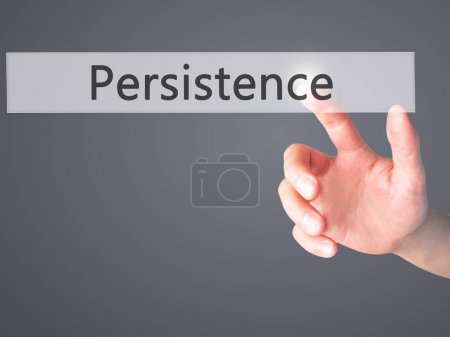 Photo for Persistence - Hand pressing a button on blurred background concept . Business, technology, internet concept. Stock Photo - Royalty Free Image