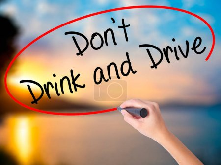 Photo for Women Hand writing Don't Drink and Drive with black marker on visual screen. Isolated on Sunset. Life, technology, internet concept. Stock Image - Royalty Free Image