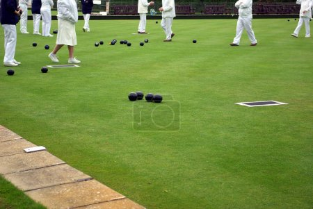 Photo for Photo showing senior people playing lawn bowling - Royalty Free Image