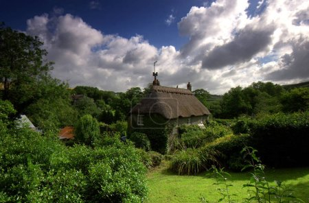 Photo for This chocolate box thatched cottage is situated in the  small hamlet called Ford which is nestled in the rolling fertile hills of the South Hams district in Devon, the area is designated an area of outstanding natural beauty. - Royalty Free Image