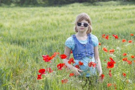 Photo for Cute young girl in poppy field - Royalty Free Image