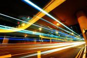 Traffic under the bridge at night