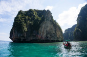 Phi Phi Island was very famous island in Phuket, Thailand. Tourist come from everyway to visit here, the was crystal clear, can see the base ocean by nake eye. The natural mountain was amazing. This is take it at small Phi Phi island, Maya bay.