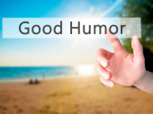 Good Humor - Hand pressing a button on blurred background concept . Business, technology, internet concept. Stock Photo