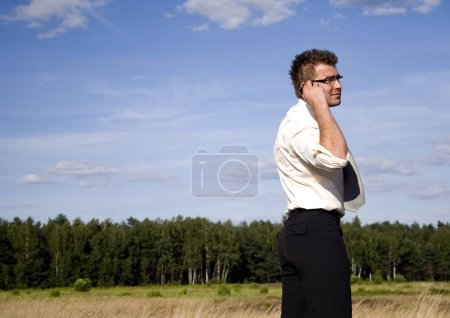 Photo for Businessman talking on mobile phone - Royalty Free Image