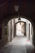 Street in the old city of Italian village Pisogne