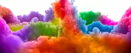 Photo for Ink in water isolated on white background. Rainbow of colors. Panorama view - Royalty Free Image