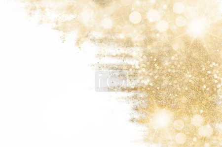 Foto de Golden Christmas background with festive shiny sparkles and twinkling bokeh, gold glitter over white with copyspace for your seasonal greetings. Festive abstract gilt background - Imagen libre de derechos