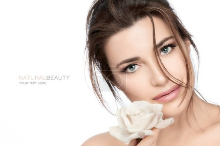 Photo for Skincare and healthy cosmetology concept. Beautiful young woman with a flawless fresh skin holding a white rose near to her lips in a beauty portrait isolated on white background - Royalty Free Image
