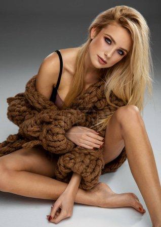 Sexy blond woman wear fashionable wool sweater