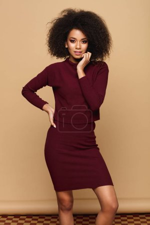 Photo for Beautiful african american woman with an afro hairstyle isolated on studio background with copy space - Royalty Free Image