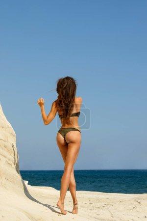 Beautiful woman on the beach beside white cliffs