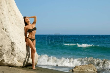 Beautiful woman on the beach beside white cliffs