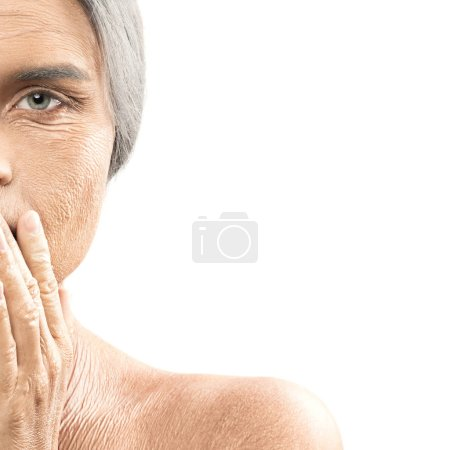 Face of elderly woman on white background