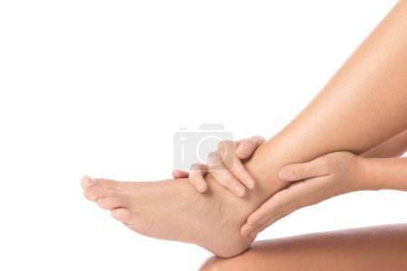 Woman is touching her injured ankle on white background