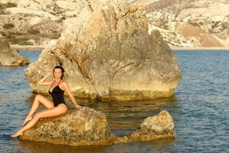 Beautiful sexy woman in black swimsuit on the famous beach at Cyprus