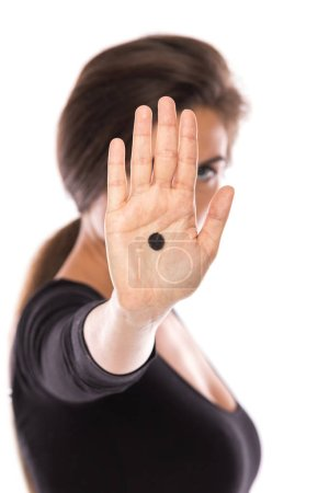 Woman with black dot on her palm give signal about domestic violence