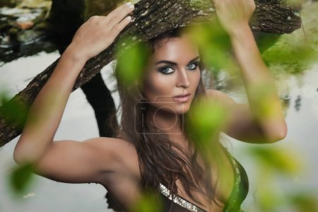 Portrait of wild beautiful young woman in tropical jungles