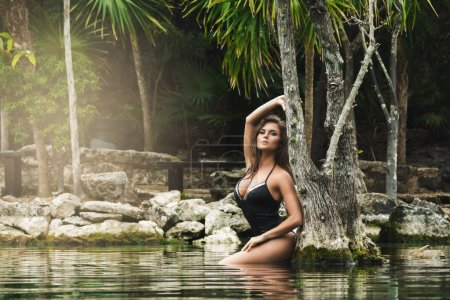 Photo for Beautiful woman with sexy body standing in water - Royalty Free Image