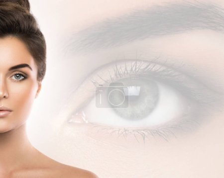 Beautiful woman and eye on background