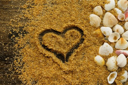 Seashells and heart drawn on the sand